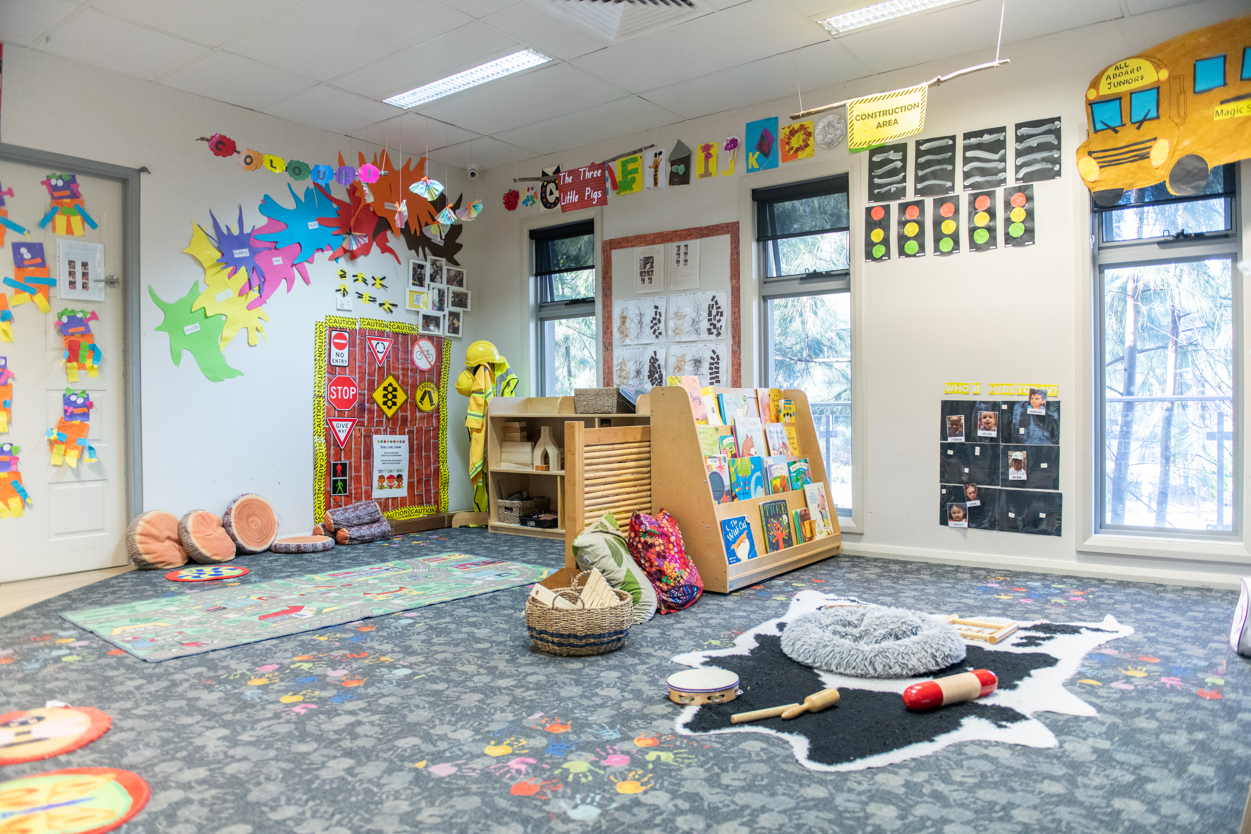 Child care educator with group of children in preschool classroom at Papilio Epping